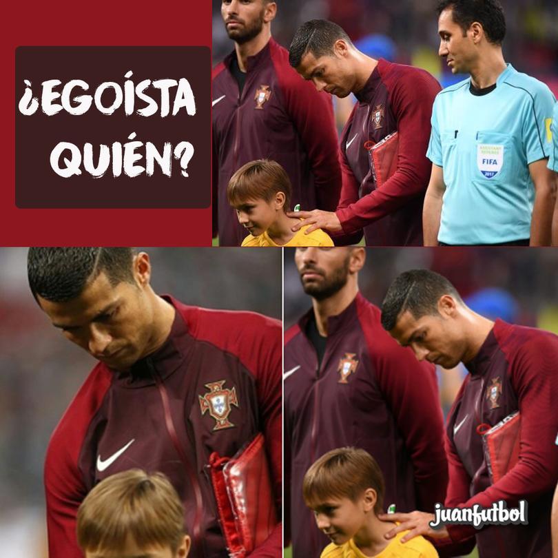 Cristiano Ronaldo le firma la camiseta a un pequeño.