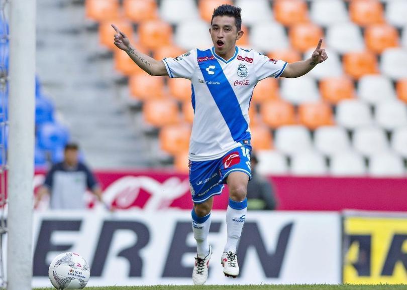 Christián Bermúdez celebra un gol con Puebla.