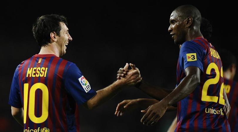 Abidal  y Messi.