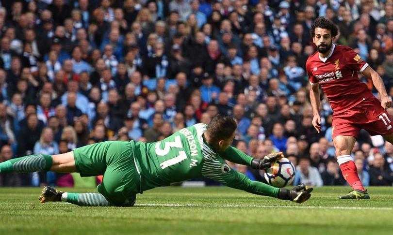 Salah y Ederson en la Premier League