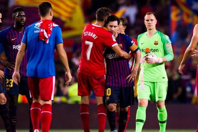 Christian Stuani y Lionel Messi