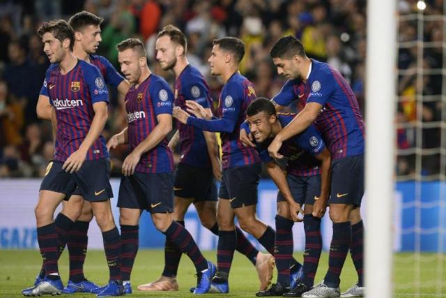 Jugadores del Barça celebran un gol de Rafinha