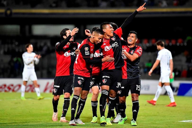 Atlas celebrando el gol