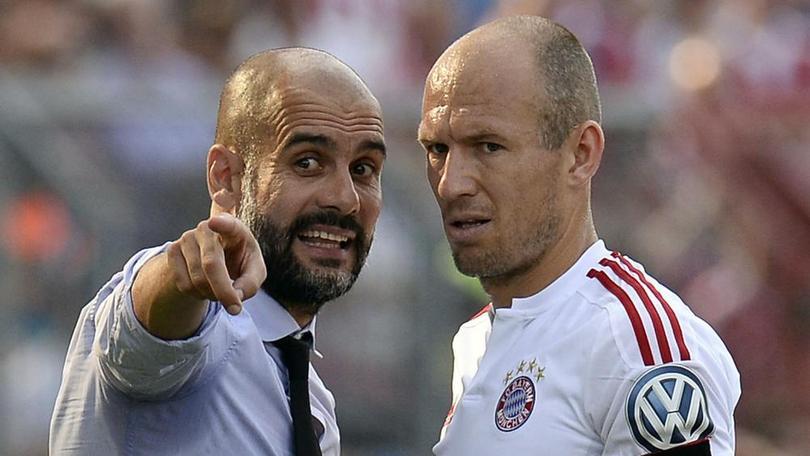 Pep Guardiola y Arjen Robben