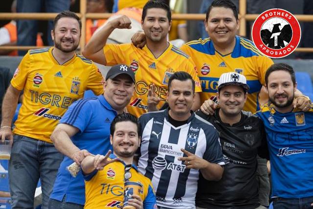 Aficionado de Rayados le regaló unos boletos a un padre e hijo de Tigres