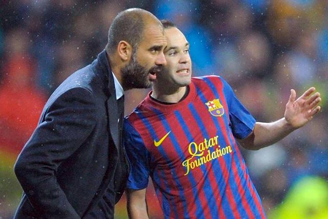Pep Guardiola y Andrés Iniesta