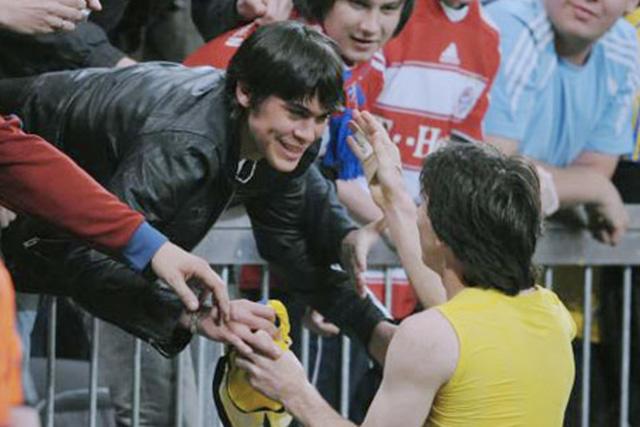 Emanuel Biancucchi con Lionel Messi