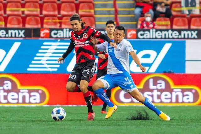 Tijuana se fue al frente muy temprano en el partido pero Puebla rescató el empate