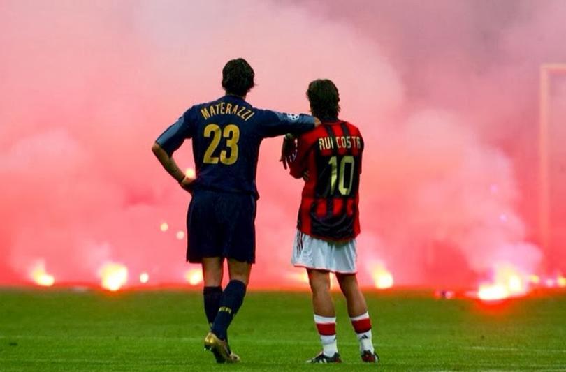 Materazzi y Rui Costa